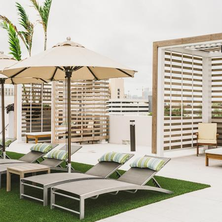 Cabanas and chaise lounges on outdoor terrace