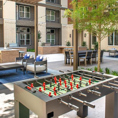 Fun outdoor gaming area with foos table and lounge spaces
