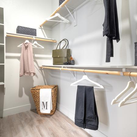 Huge walk-in closets with built-in shelving