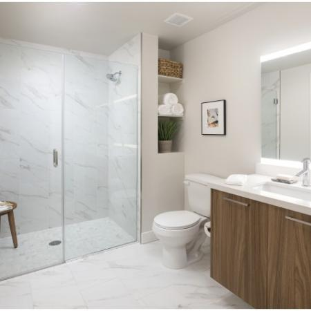 Stunning bathroom with walk in showers and built in custom cabinetry