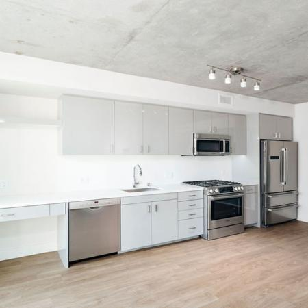 Spacious homes with Galley kitchens, built in desk and side by side double refrigerators at Modera Rincon Hill apartments.