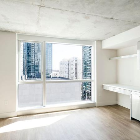 Gorgeous apartments with exposed concrete ceilings at Modera Rincon Hill apartments.