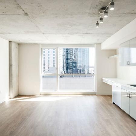 Spacious apartment homes with stunning views, wood vinyl flooring and built in desk at Modera Rincon Hill apartments.