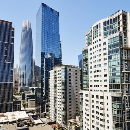 City life on the balcony in the sun at Modera Rincon Hill.