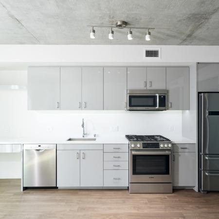 Light and airy sleek grey lacquer cabinets in an apartment at Modera Rincon Hill.