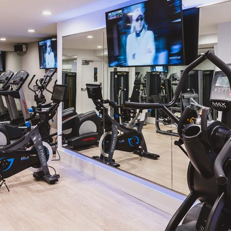 New MAX Fitness spin bike and stair climber in gym