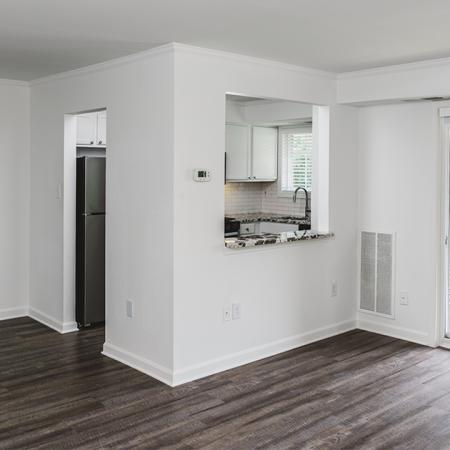 Upgraded home with brown wood plank-style flooring and sliding glass doors to patio