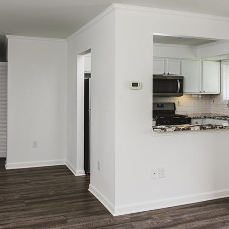 Upgraded home with breakfast bar peeking into kitchen