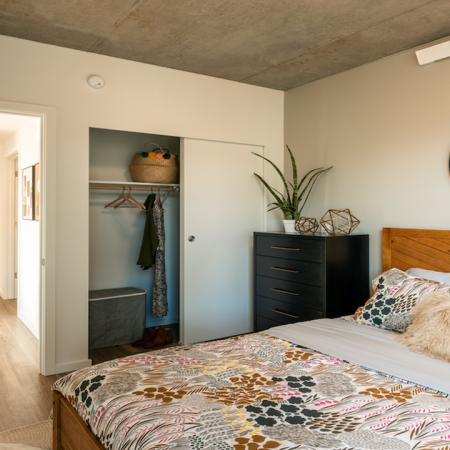 Large bedrooms with closets with built in shelving