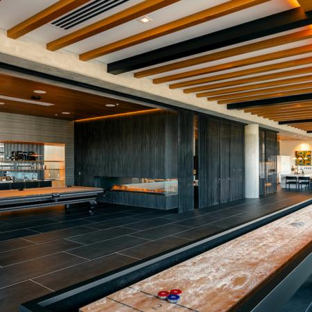 Clubroom features gaming area with shuffle board and billiards