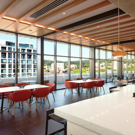 Clubroom features gathering tables and workspace areas