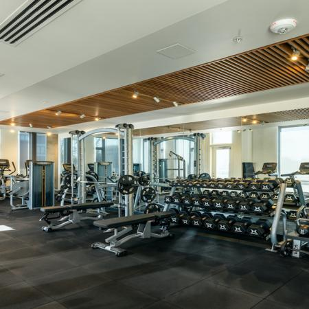 Expansive fitness studio with kettlebells, free weights and more