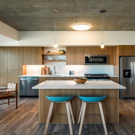 Gourmet kitchens with gas cooking french door refrigerators, and chef's island with breakfast bar