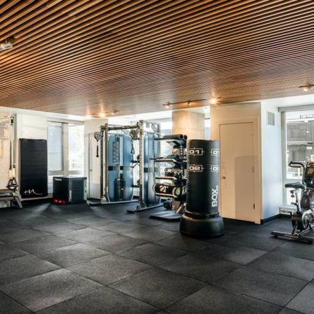 Spacious fitness studio with TRX, boxing and spin bikes