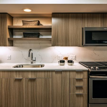 Ample kitchen storage with built in custom shelves.