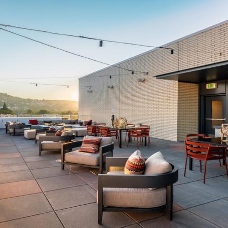 Rooftop lounge with grilling and dining stations