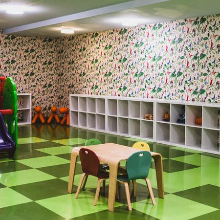 Community children's room with toys and indoor playscape