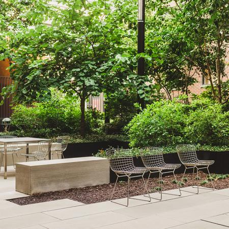 Landscaped outdoor patio with seating and tables