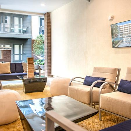 Outdoor Resident Lounge with Social Seating and Wall Mounted Television