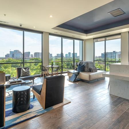 Resident Lounge with Floor to Ceiling Windows and Demonstration Kitchen
