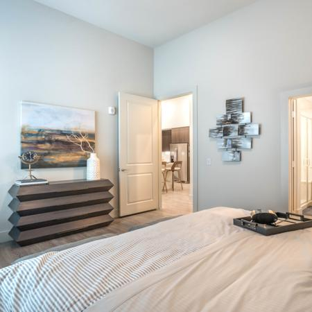 Eloquently Designed Guest Bedroom with Large Walk In Closet