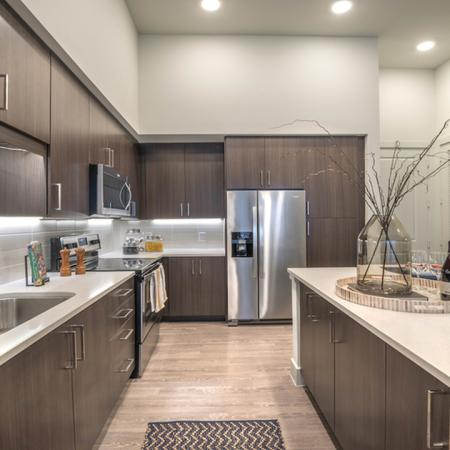 Expansive Open Concept Kitchen With Espresso Cabinetry and Island