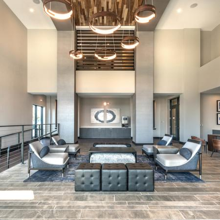 Resident Lounge with Unique Lighting and Porcelain Tile Flooring