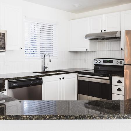 Well appointed and brightly lit open concept kitchen