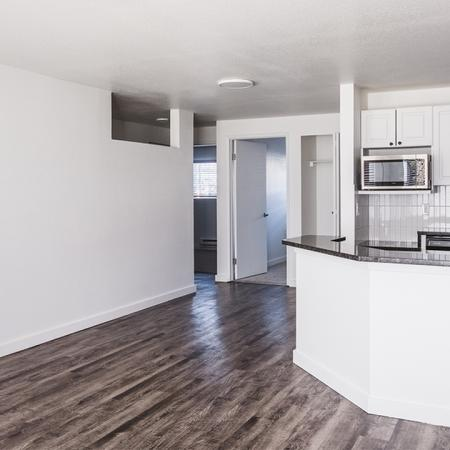 From living area, open breakfast bar to a newly redesigned kitchen