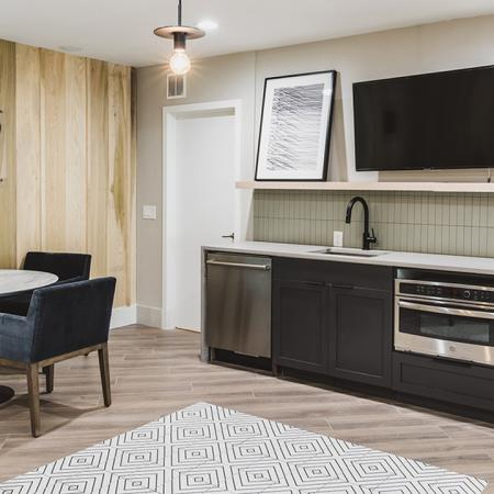 Newly reimagined clubroom with seating and kitchen area