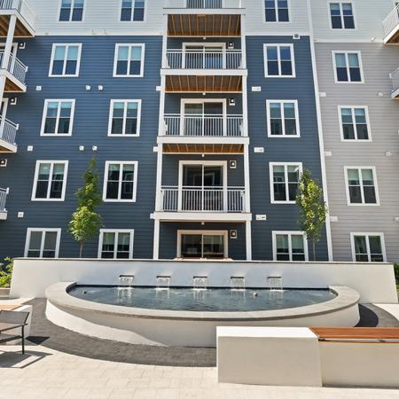 Outdoor patio with balconies and fountain