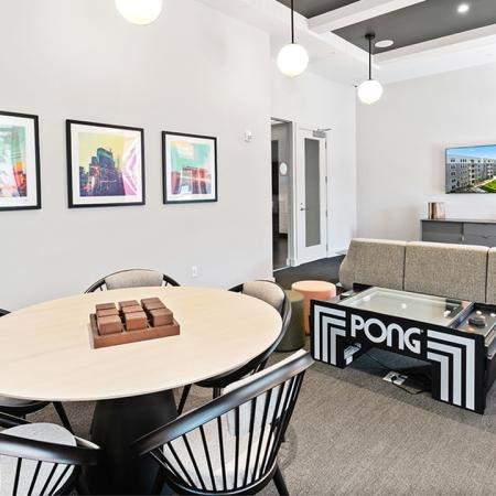 Gaming area with pong table and lounge areas