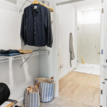 Large walk-through closets with built-in shelving