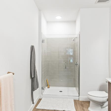 Large glass-enclosed showers and large bathrooms