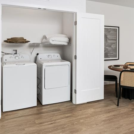 Side by side full size washer and dryer and shelving