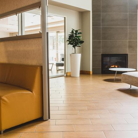 Clubroom seating in front of a fireplace