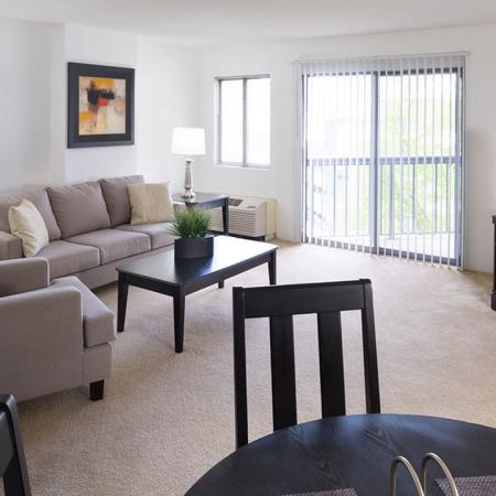 Living room in NW tower home with sliding glass door to balcony