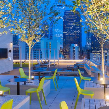 Rooftop deck at night with views of Philadelphia