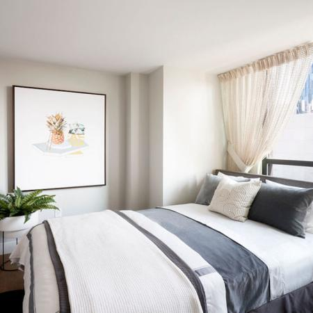 Light-filled homes and large bedroom at Modera Rincon Hill apartments.