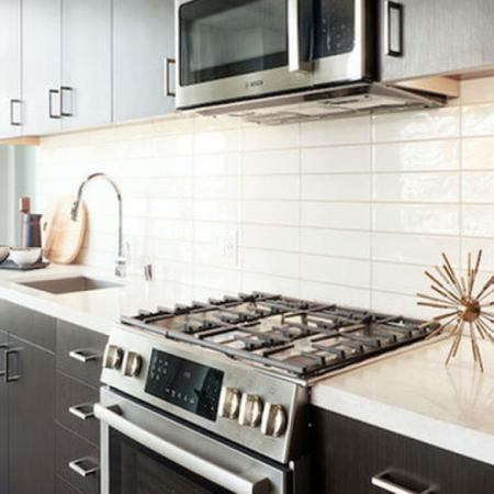 Beautiful kitchens with sleek gas ranges and plentiful storage at Modera Rincon Hill apartments.