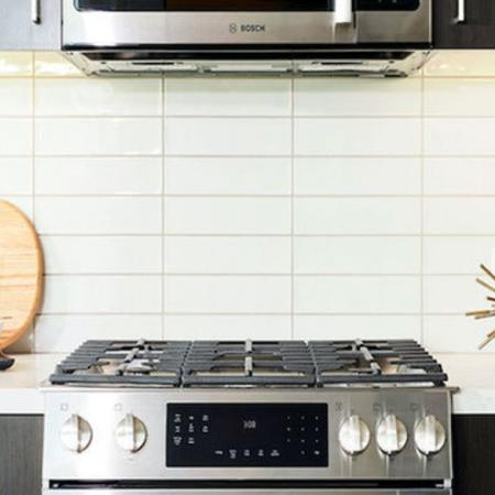 Luxury gas range with electric oven at Modera Rincon Hill apartments.