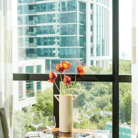Take in your morning coffee while enjoying views of the city and San Francisco Bay Bridge at Modera Rincon Hill apartments.