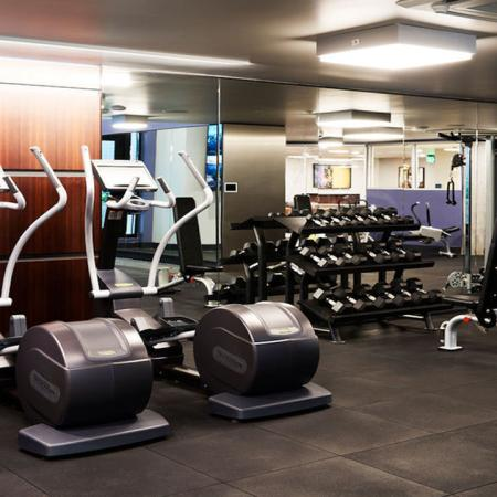 Ellipticals, free-weights and weight stations at Modera Rincon Hill apartments.