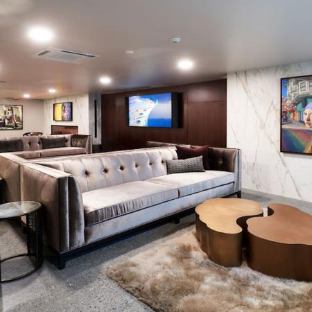 Lounge area social space with plush seating at Modera Rincon Hill apartments.