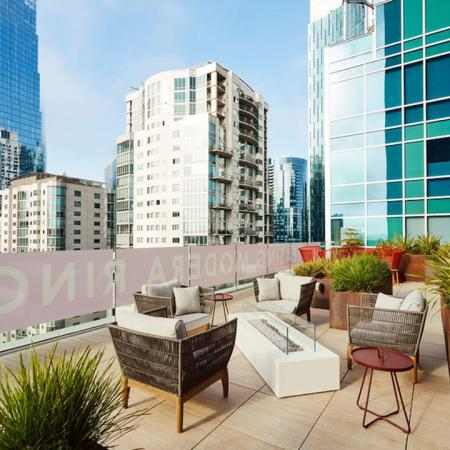 Stunning rooftop lounge areas with spectacular views at Modera Rincon Hill apartments.