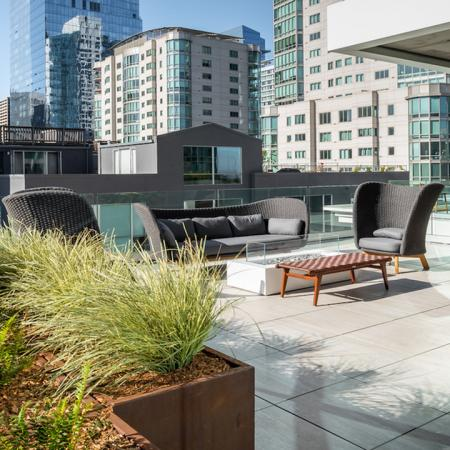 Outdoor lounge area and gathering spaces at Modera Rincon Hill apartments.