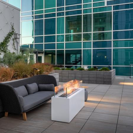 Take in the San Francisco Bay Bridge with firepits and cozy lounge spaces at Modera Rincon Hill apartments.