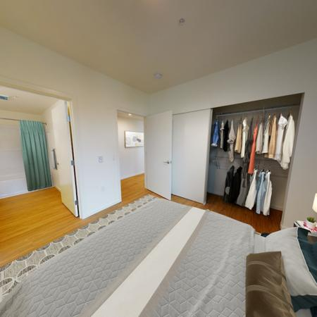 Large bedroom with closets with built in shelving