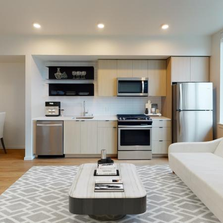 Spacious studio homes with built in shelves and galley kitchens at Modera Broadway Apartments