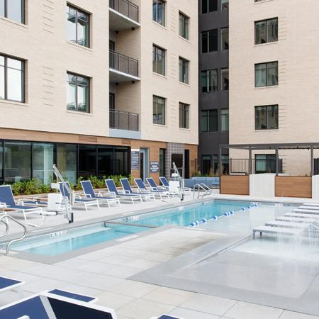 courtyard pool view with lounge seating and water feature